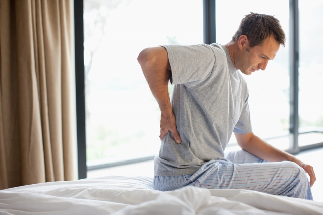 What is the best position to sleep for back pain?